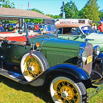 Classic cars lined up at an outdoor show